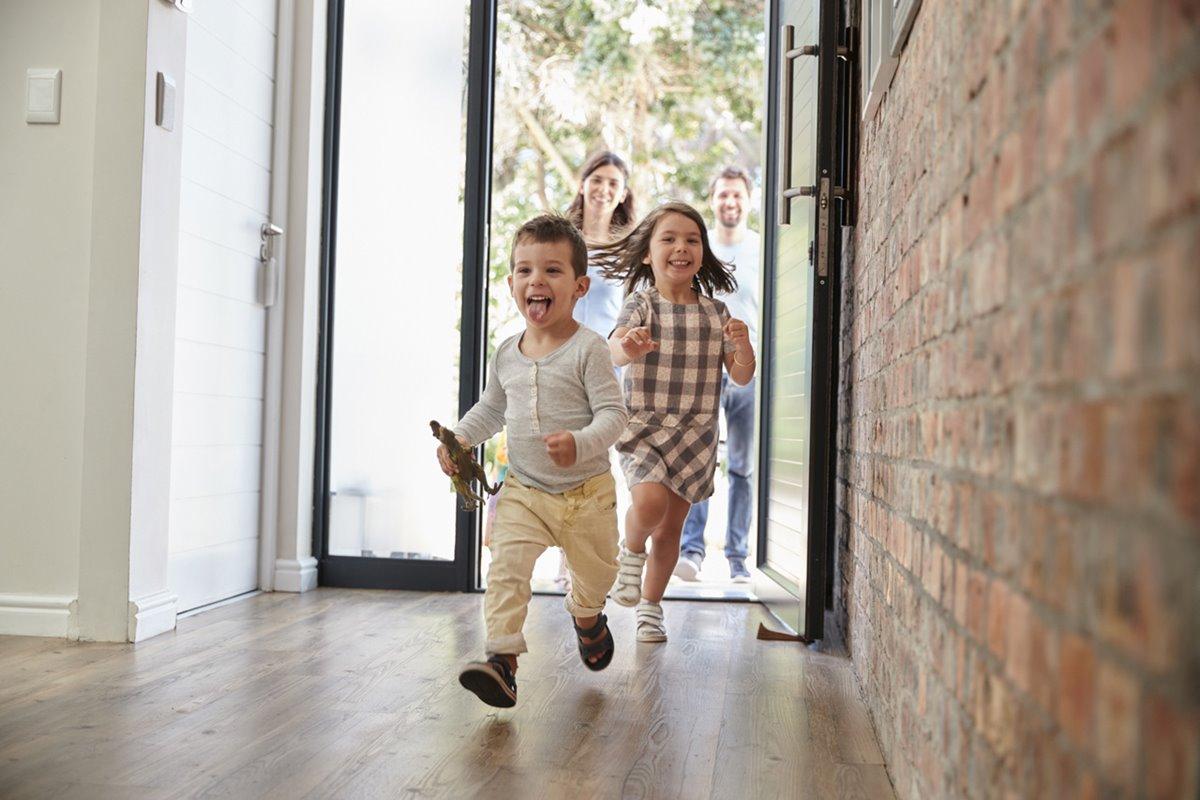 children running into home with glass door