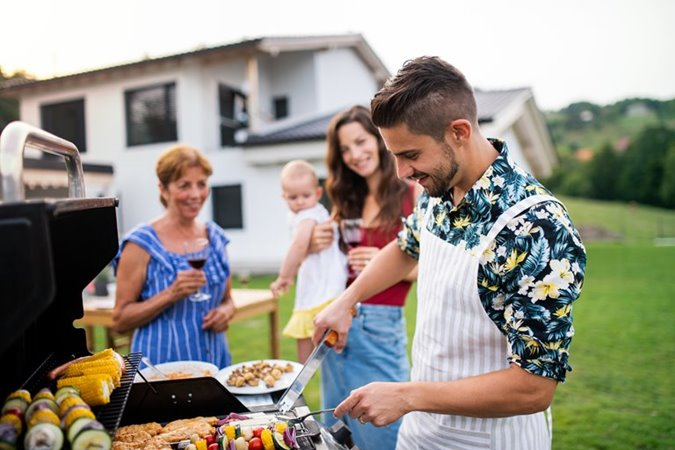 Family is having a BBQ in their garden