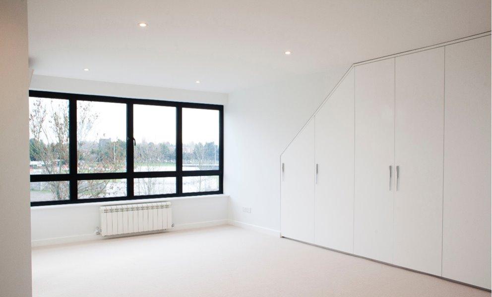 Large black aluminium windows in modern bedroom