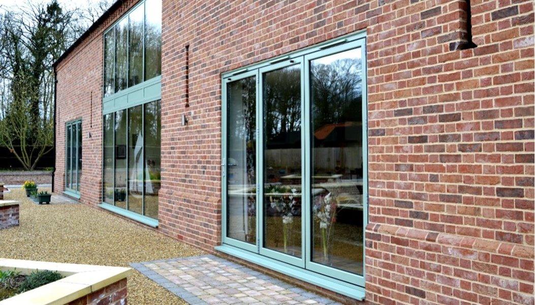 Chartwell green finish aluminium doors from outside