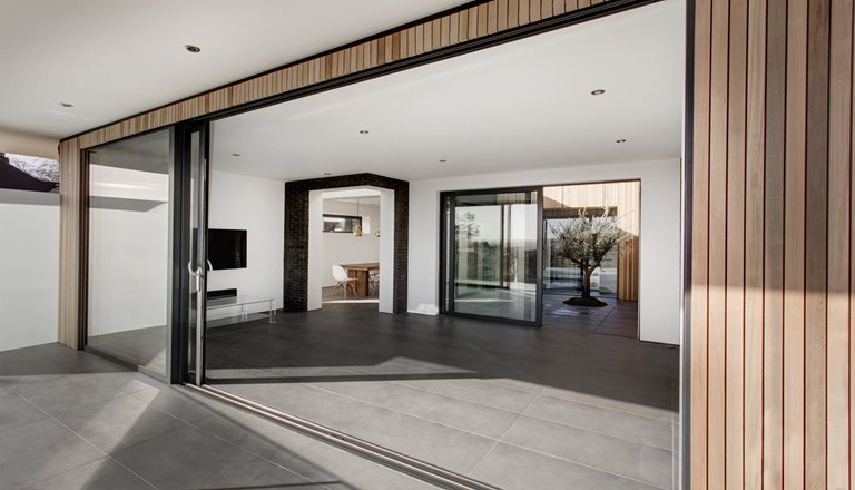 Large sliding door in a modern house from outside