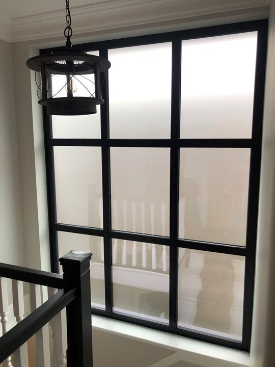 Black aluminium window in a modern house