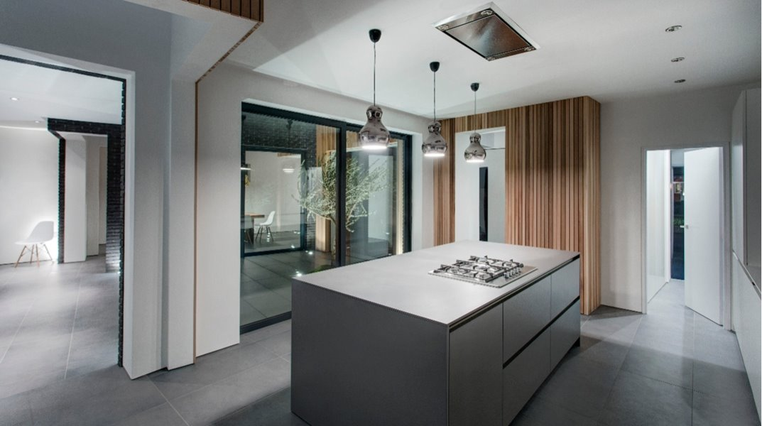 Large sliding doors in contemporary kitchen