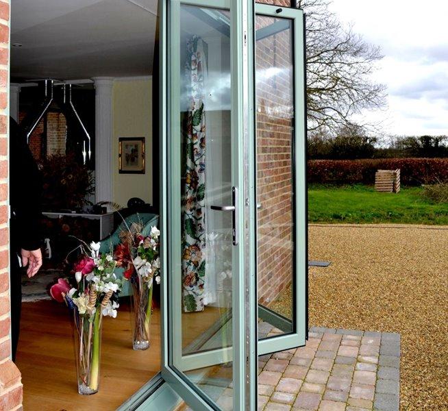 Open aluminium chartwell green bifold doors