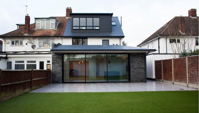 A modern semi-detached house with a garden