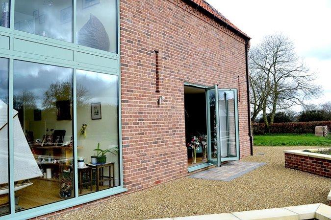 Barn style house with aluminium bifolds
