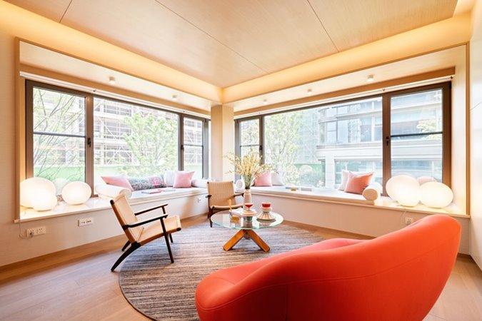 Living room view with orangechair