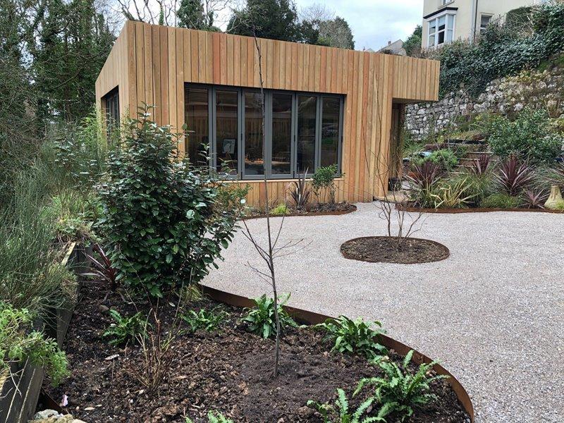 Garden building with black aluminium bifold doors