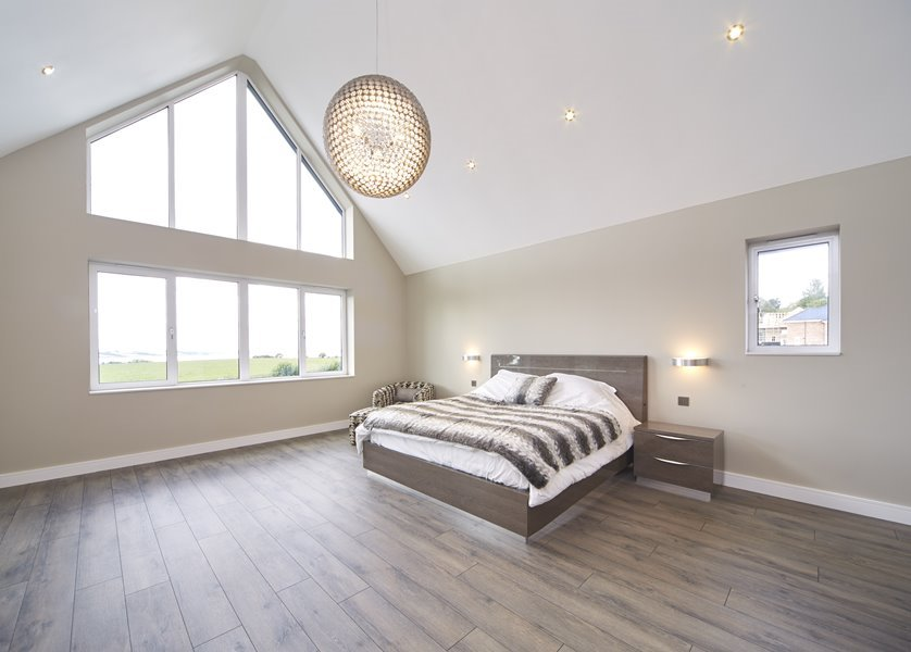 White aluminium large glazing in a bedroom