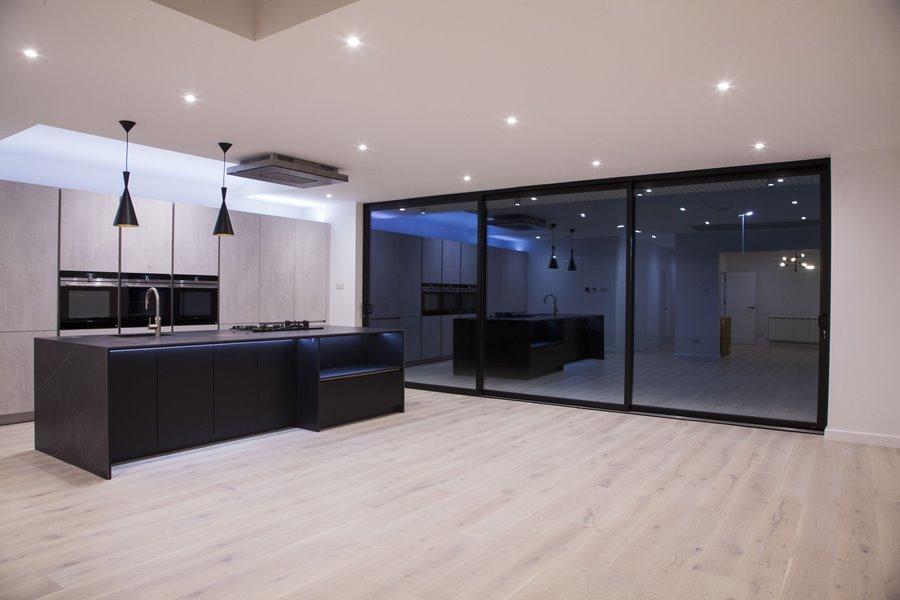 Black sliding doors in a kitchen