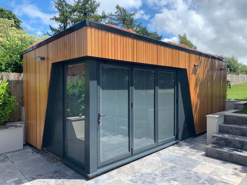 Garden room with grey aluminium bifold doors