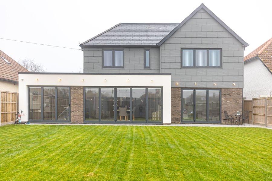 Modern grey house with a garden